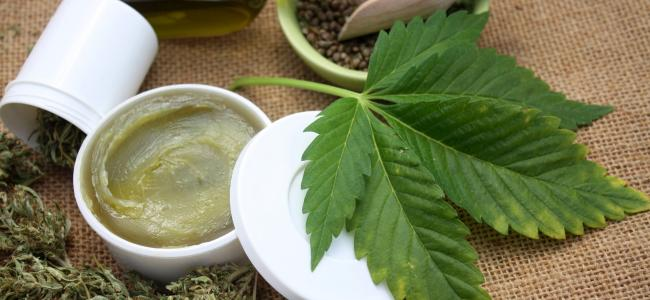 An image of a cannabis leaf, oil, seeds, dry leaves, and a salve is shown.