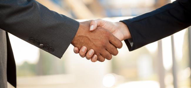 An image of a handshake is shown.