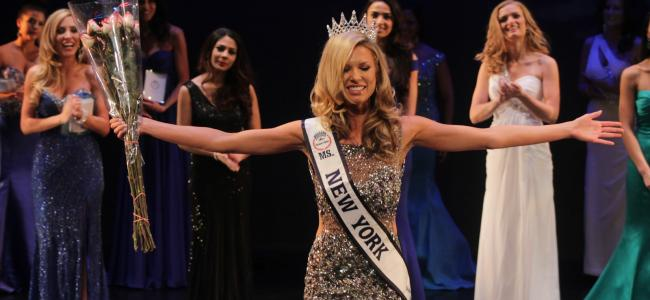 An image of contestants in a beauty pageant is shown.