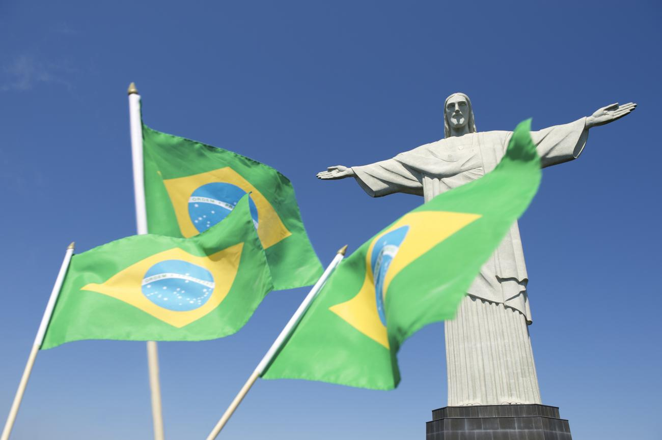 An image of Brazilian flags waving at Corcovado Rio de Janeiro is shown.