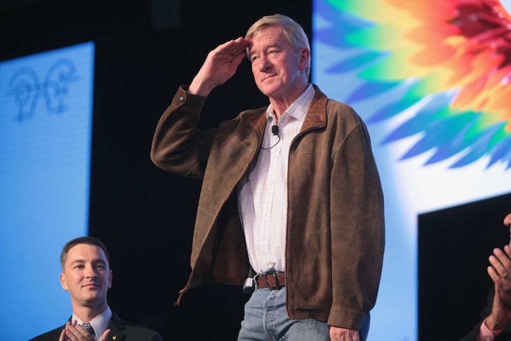 An image of former Massachusetts Governor William Weld saluting is shown.