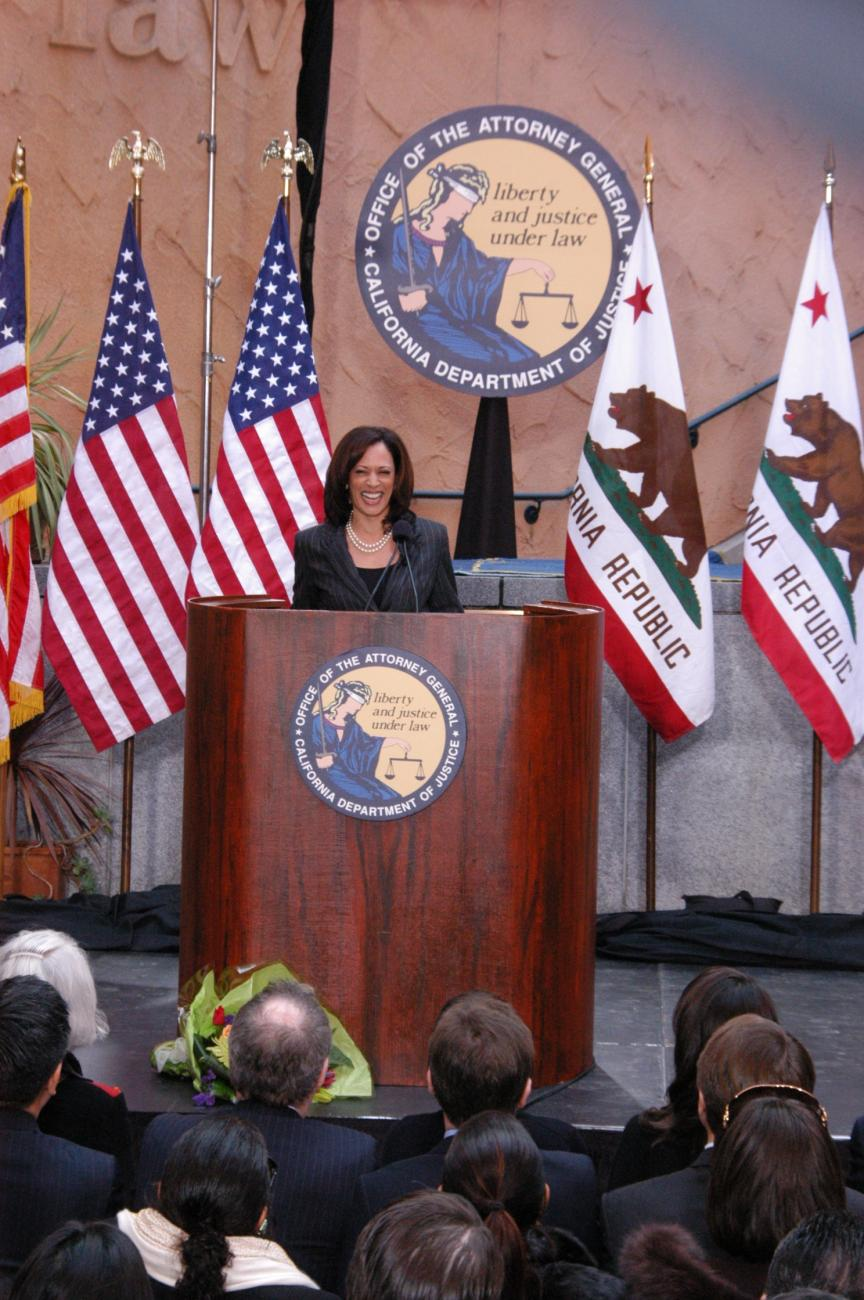 An image of Senator Kamala Harris standing behind a podium is shown.